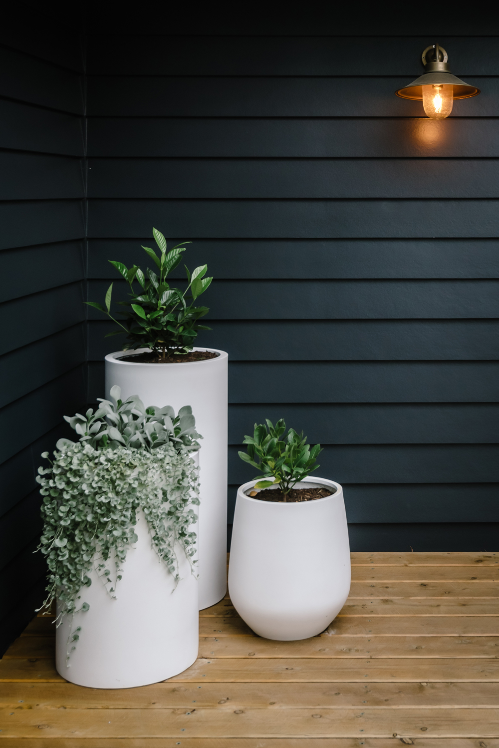 White planter pots from Balcony Garden on front porch